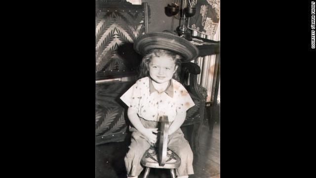 Like so many girls, Edwarda loved horses -- even the wooden variety. (CNN)