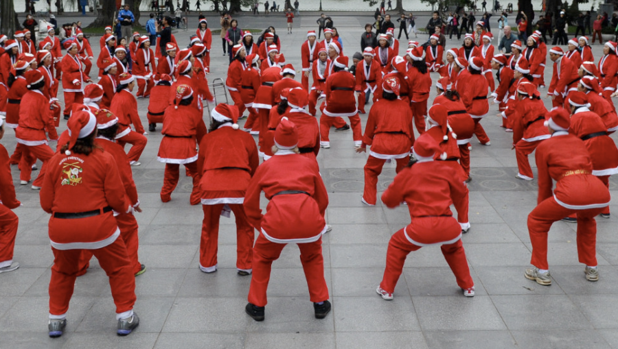 Members of a local yoga club perform at a public park wearing Santa Claus costumes in Hanoi, Vietnam, on December 23. (Photo: CNN)