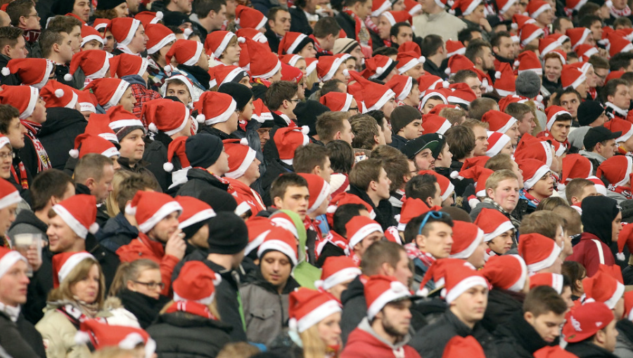 Stuttgart fans don Santa hats during a German Cup match between VfB Stuttgart and 1. FC Köln on December 19 in Stuttgart, Germany. (Photo: CNN)