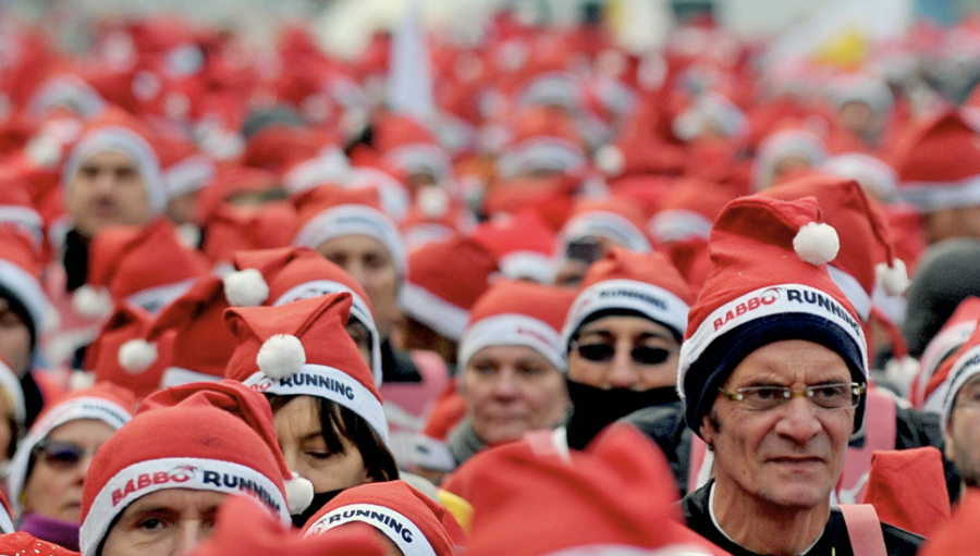 Participants wear Santa costumes as they take part in a Santa Claus-themed race in downtown Milan, Italy, on December 16. (Photo: CNN)