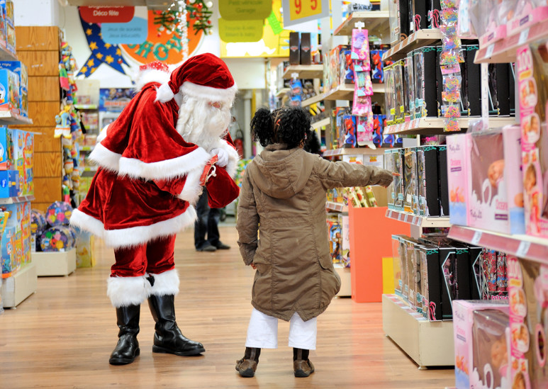 A girl points out toys to Santa Claus on Saturday, December 15, in a store in Lille, France. (Photo: CNN)