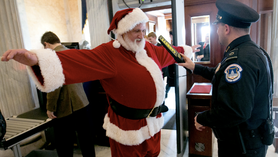 Police check a man dressed as Santa Claus as he passes through a metal detector at the U.S. Capitol on Wednesday, December 12, in Washington. (Photo: CNN)