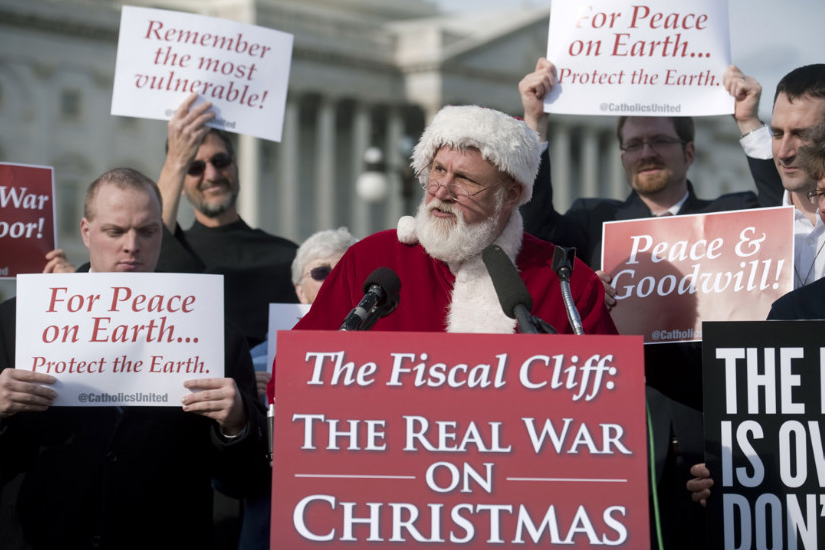 Catholics United hold a press conference with Santa Claus in front of the U.S. Capitol to rebut the GOP's budget effort in the ongoing fiscal cliff argument on December 12 in Washington. (Photo: CNN)