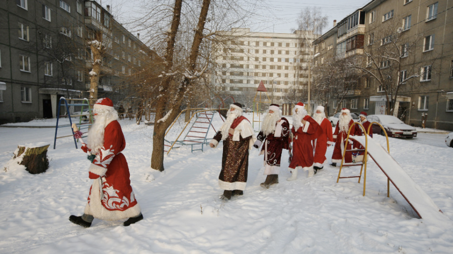 "Costumed participants of the annual ""Best Father Frost"" contest from different city districts make their way through a courtyard in Krasnoyarsk, Russia, on Monday, December 10. (Photo: CNN)"