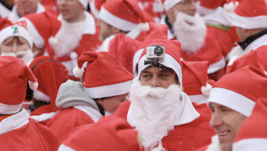 Participants in the fourth annual Michendorf Santa Run, one wearing a camera on his head, gather shortly before the run on December 9 in Michendorf, Germany. More than 800 people took part in this year's races. (Photo: CNN)