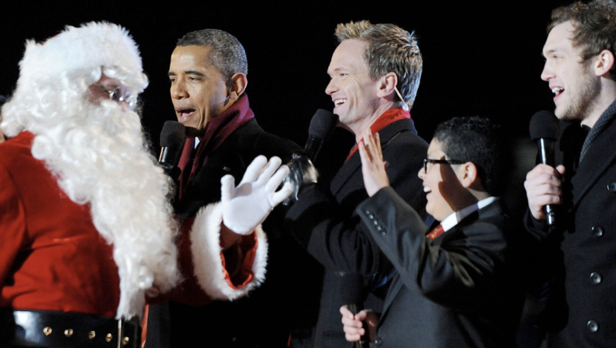President Barack Obama greets Santa Claus with actors Neil Patrick Harris, Rico Rodriguez and musician Phillip Phillips during the 90th National Christmas Tree Lighting Ceremony at the White House on Thursday, December 6, in Washington, D.C. (Photo: CNN)