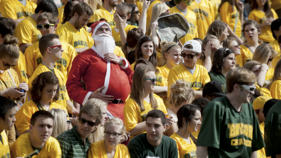 A fan of the Baylor University Bears dresses up as Santa Claus while the Bears face the Oklahoma State University Cowboys on Saturday, December 1, in Waco, Texas. (Photo: CNN)