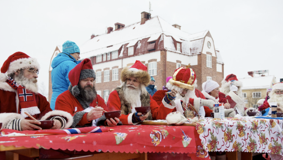 Santas from various countries compete in the porridge-eating contest during the Santa Claus Winter Games in Gallivare on November 17. (Photo: CNN)