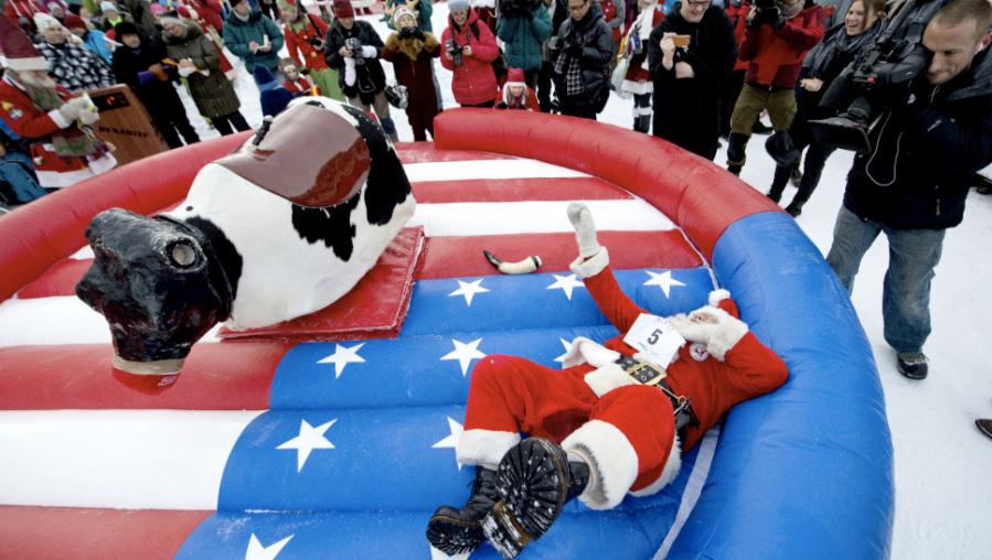 "Japanese Santa Claus ""Santa Paradise Yamamoto"" hits the ground in the reindeer ride event during the competition in Gallivare on November 17. (Photo: CNN"