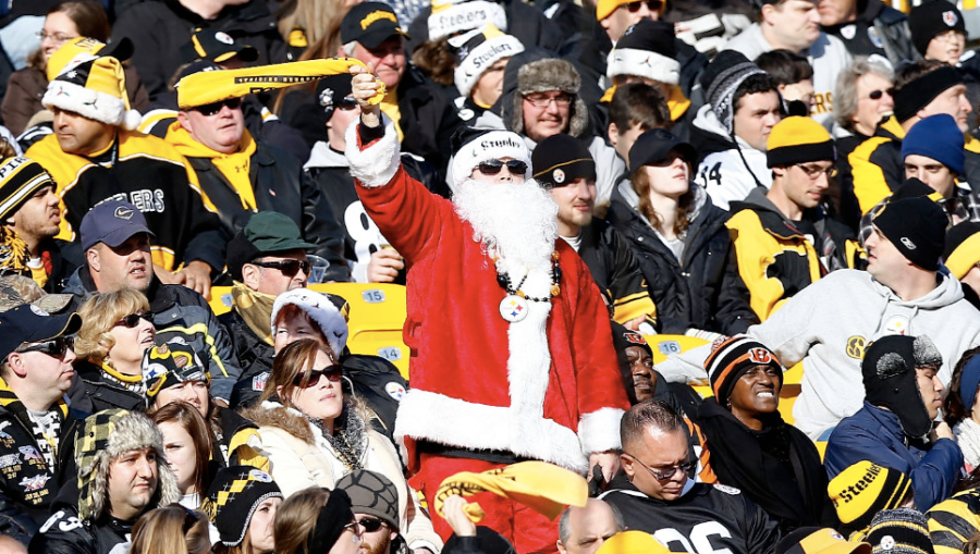 A Steelers fan in a Santa outfit waves his Terrible Towel during the game between the Pittsburgh Steelers and Cincinnati Bengals on Sunday, December 23, in Pittsburgh. (Photo: CNN)