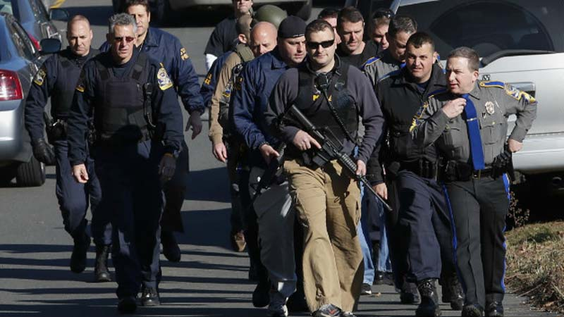 Police patrol the streets around Sandy Hook Elementary School on Dec. 14, 2012 (Photo: CNN)