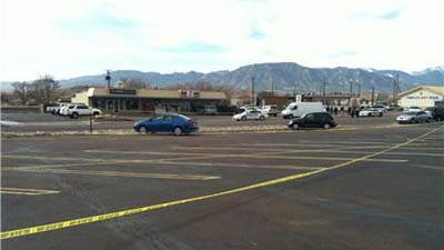 Police investigate the scene of a shooting in the Security-Widefield area where a wanted man was killed on Dec. 21, 2012. (Photo: KXRM)