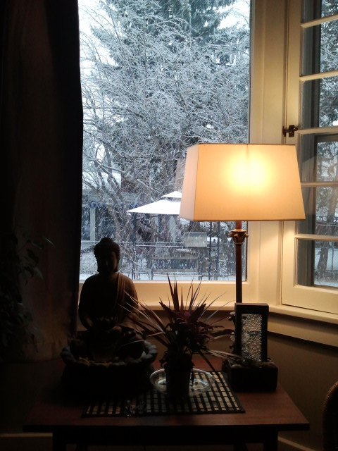 Warm inside an Arvada home while the snow falls outside.