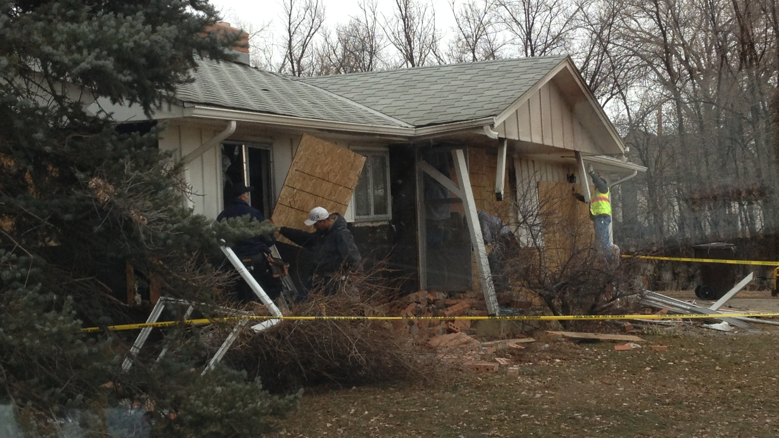 Boulder Sheriff's deputies and a bystander rescued a woman from her burning home Saturday.