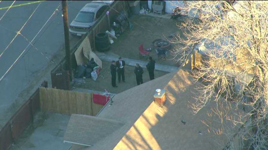 Police investigate the scene of a shooting that claimed multiple victims in north Denver on the morning of Feb. 6, 2013.