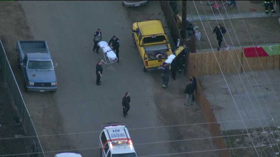 Emergency personnel transport a victim away from a shooting in north Denver on Feb. 6, 2013.
