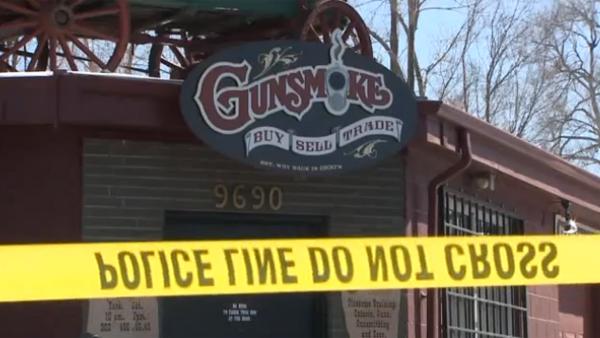 Police investigate at the scene of a burglary at the Gunsmoke gun shop in Wheat Ridge on Feb. 27, 2013.