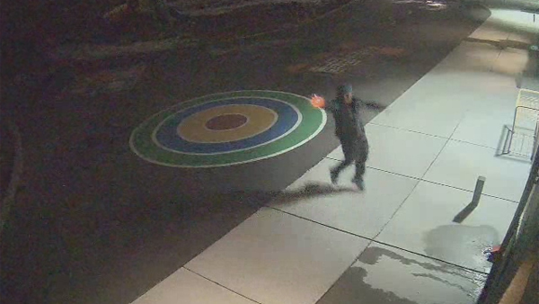One of the two suspects is caught on surveillance camera shooting while fleeing in Denver on March 12, 2013. (Photo: Denver Police Department)