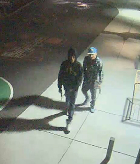Surveillance camera footage shows two suspects entering the scene of a shooting in Denver on March 12, 2013. (Photo: Denver Police Department)