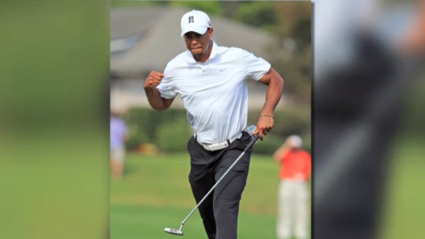 Tiger Woods fist pumps after holing a put at the Arnold Palmer Invitational tournament on March 25, 2013. (Photo: CNN)