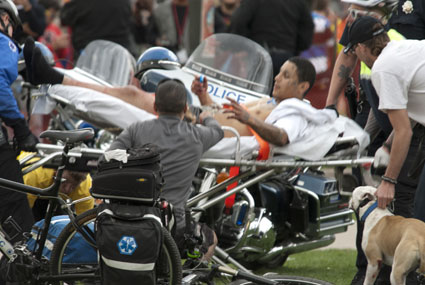 A man is taken away on a stretcher after shots were fired at Denver's Civic Center Park 4/20 rally on April 20. The shooting is thought to have been gang-related.(Photo courtesy: Daniel Harlan)