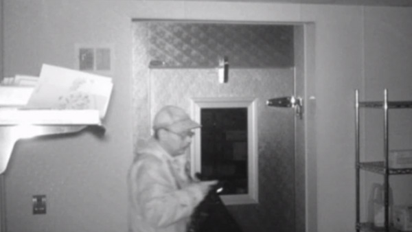 Surveillance footage shows hermit Christopher Knight in the process of one of over 1,000 burglaries over the course of 27 years in the Maine woods. (Photo: CNN)