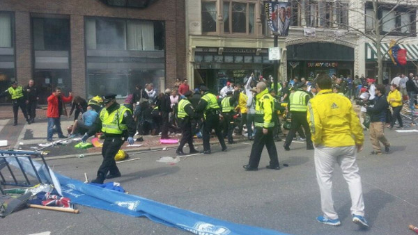 Emergency crews look to create order in the midst of chaos after a pair of explosions near the finish line of the Boston Marathon on April 15, 2013. (Photo: Twitter/ DavidKenner)