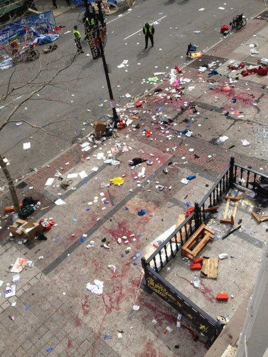 Blood and wreckage are left at the scene of two explosions at the finish line of the Boston Marathon on April 15, 2013. (Photo: Twitter / @brm90)