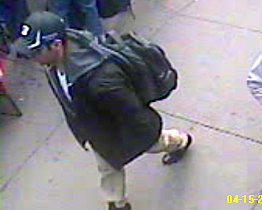 "Suspect ""1"" wears a black hat"