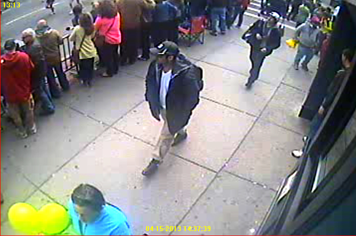 Suspect 1 (black hat in front), suspect 2 in white hat