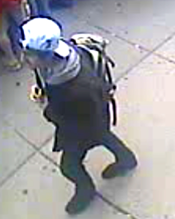 "Suspect ""2"" wears a white hat"