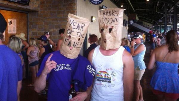 "A pair of ""Colorado Rockies Boycott"" enthusiasts protest at Coors Field at a 2012 game. (Photo: Facebook / Colorado Rockies Boycott)"