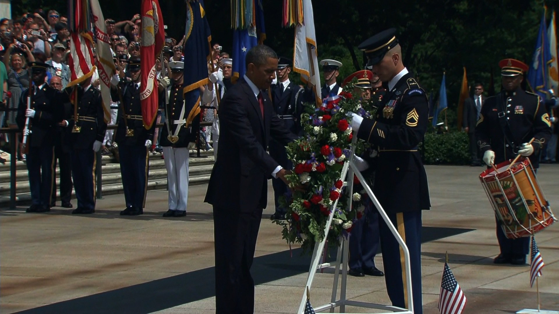 President Barack Obama lays a wreath at the Tomb of the Unknowns at Arlington National Cemetery on Memorial Day, May 27, 2013. (Credit: CNN)
