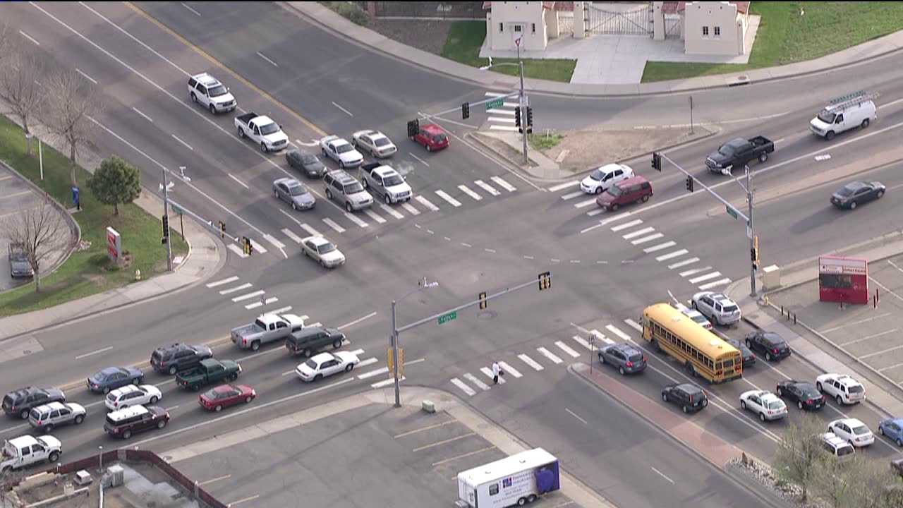 Vehicles proceed cautiously through one of the many Aurora intersections to experience traffic signal malfunctions on the morning of May 15, 2013.