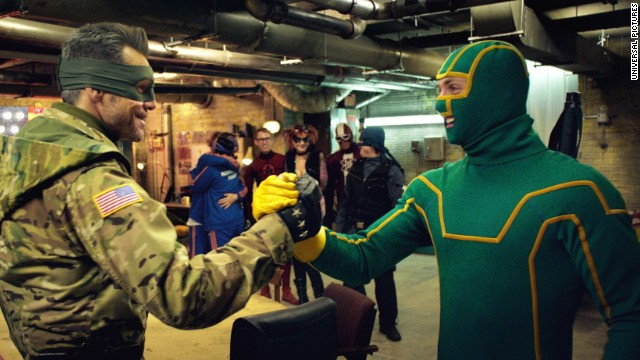"""Jim Carrey (left) and Aaron Taylor-Johnson appear in """"Kick-Ass 2."""" (Credit: Paramount Pictures)"""