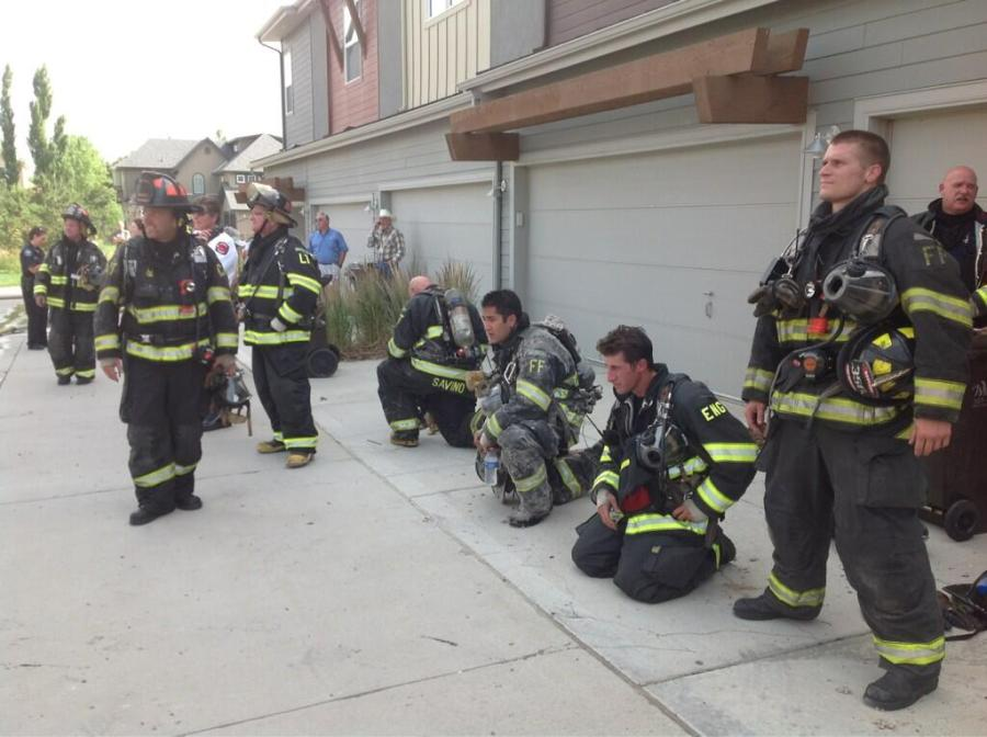 Firefighters enjoy fresh air after facing smoke filled condo.(Credit: Boulder Police)