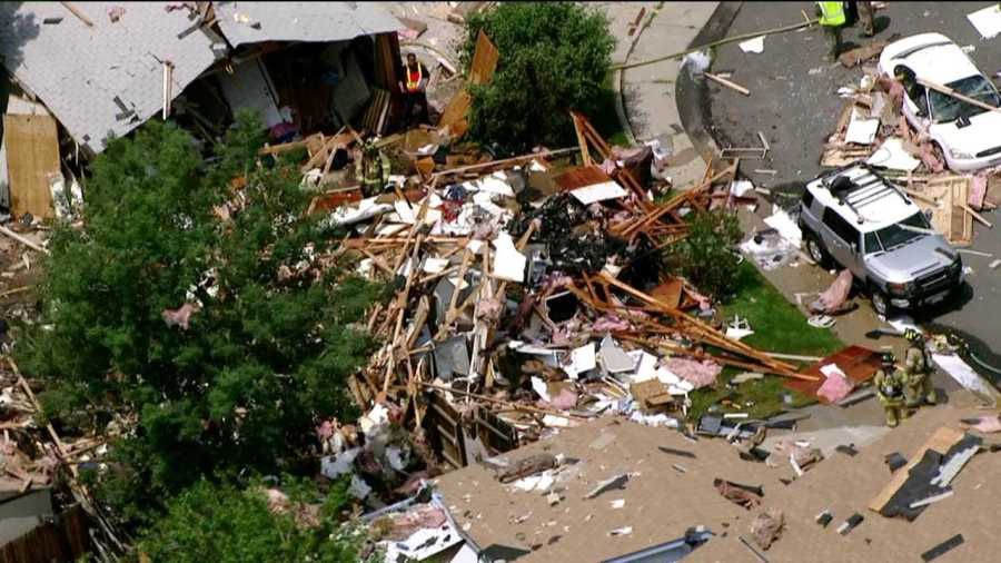 Emergency crews work at the scene of a natural gas explosion that leveled property in Westminster on June 13, 2013.