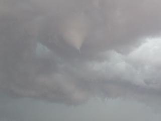 Funnel cloud forming in east metro Denver