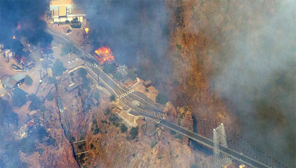 Fire consumes buildings in the Royal Gorge Park, just north of the iconic suspension bridge on June 12, 2013.