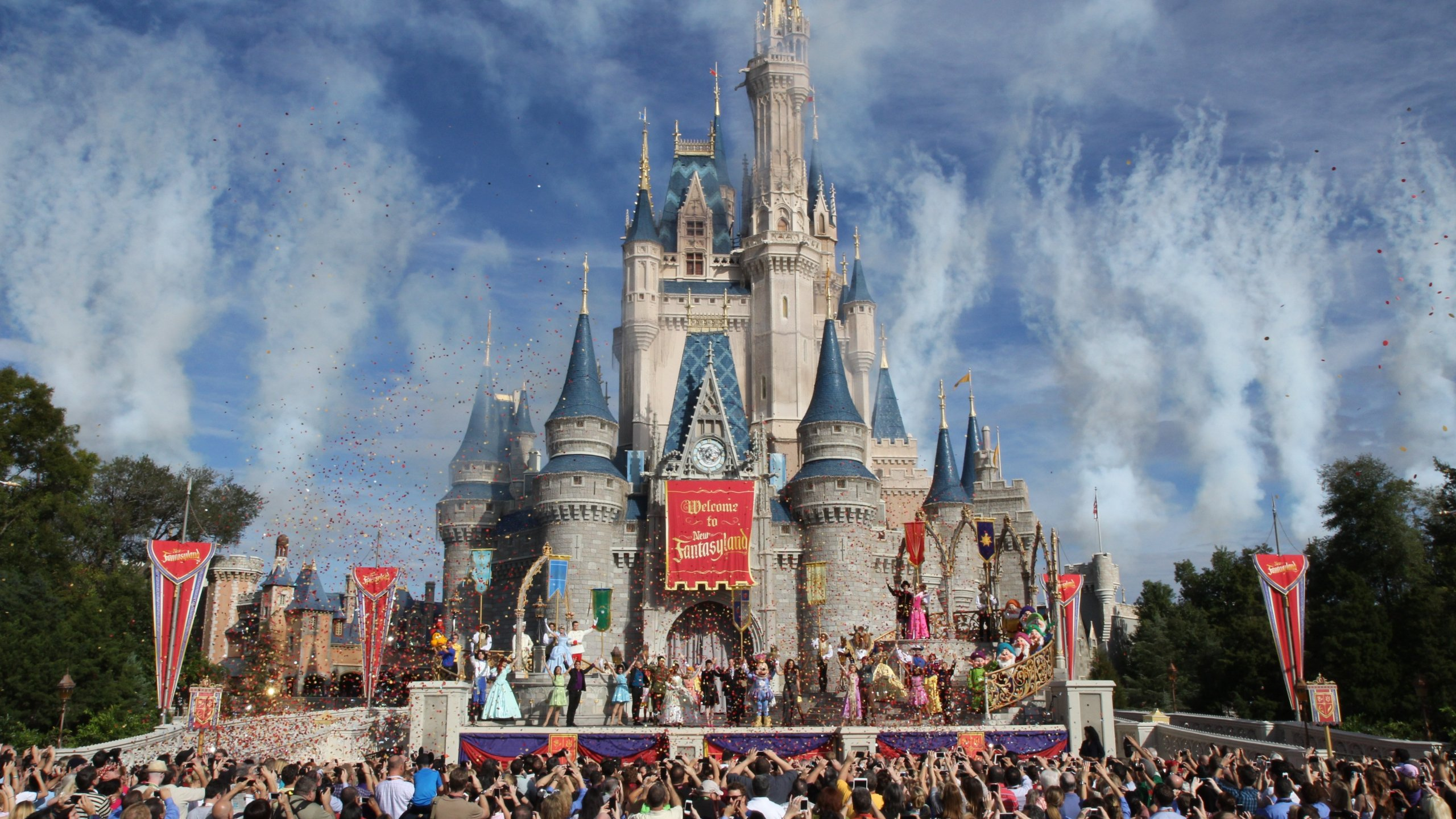 Disney World patrons watch the grand opening ceremony of the new Fantasyland expansion on December 6, 2012. (Credit: CNN)