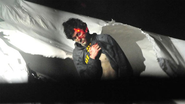 Boston Marathon bombing suspect Dzhokhar Tsarnaev emerges from the boat where he hid from police, his face smeared with blood. (Photo: Photo: Sean Murphy, Boston Magazine)