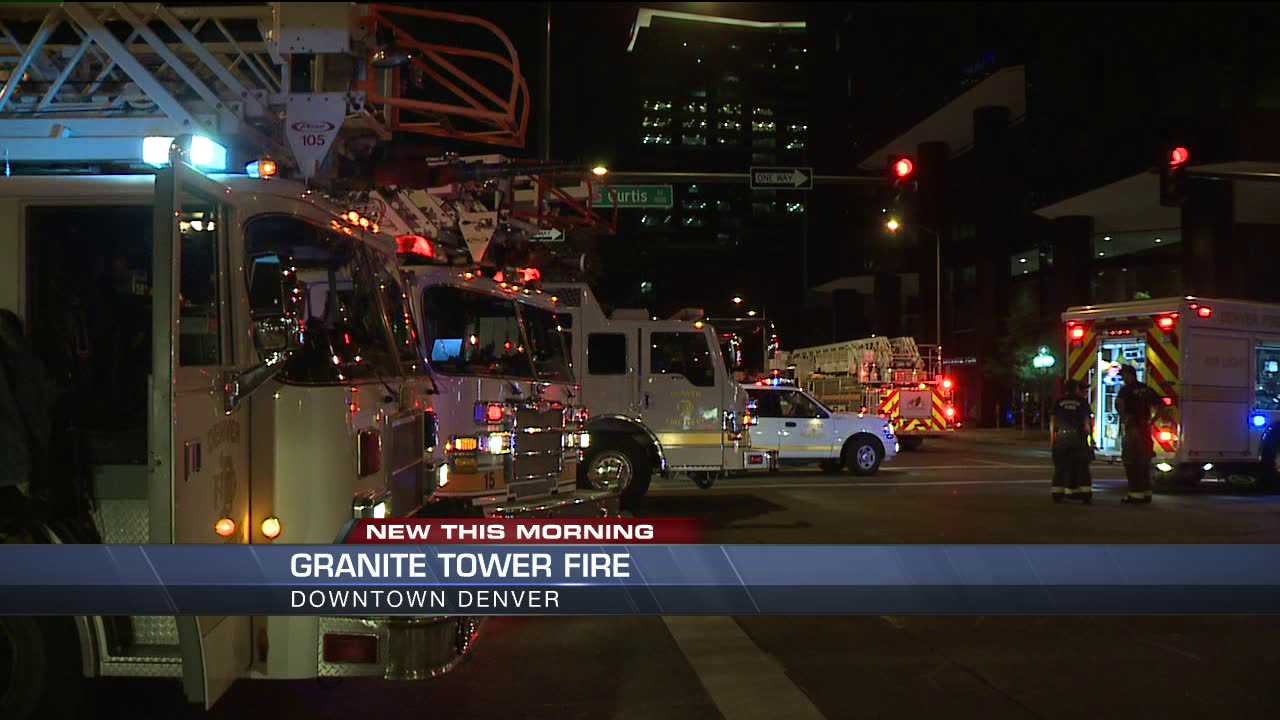 Firefighters gather near the scene of an electrical fire at Granite Towers in downtown Denver on July 12, 2013.