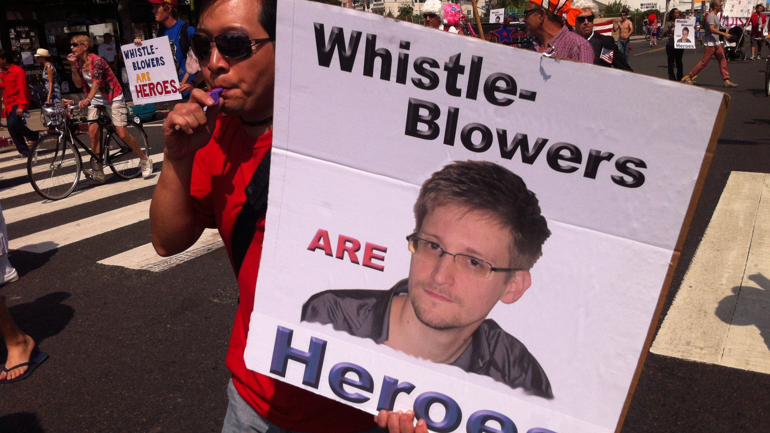 Supporters of Edward Snowden rally recently. (Credit: CNN)