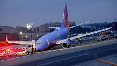 Southwest Airlines Flight 345 had a nose gear collapse on landing at LaGuardia in NY. July 22, 2013