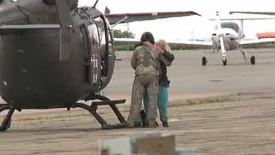 Grateful evacuee hugs a National Guard member