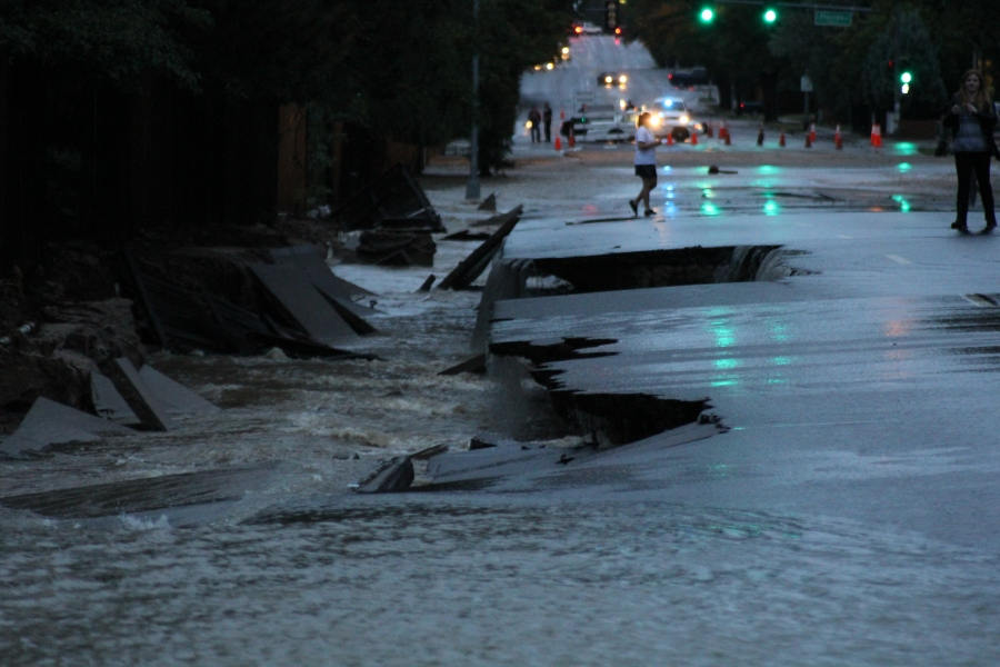The sidewalk and parts of the road were washed away at Peoria and Mexico in Aurora on Sept. 13, 2013.