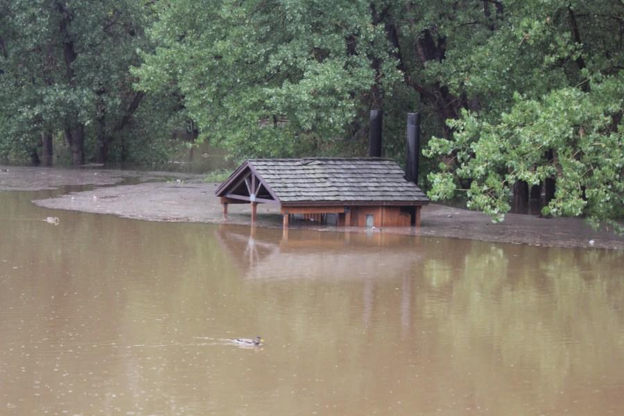 A restroom is flooded near Bear Creek Lake on Sept. 13, 2013.