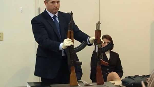 An AK-47 semi-automatic replica, right, is shown next to the real thing at a court proceeding for a California police officer accused of fatally shooting a boy carry the fake rifle. (Photo: CNN / KGO)