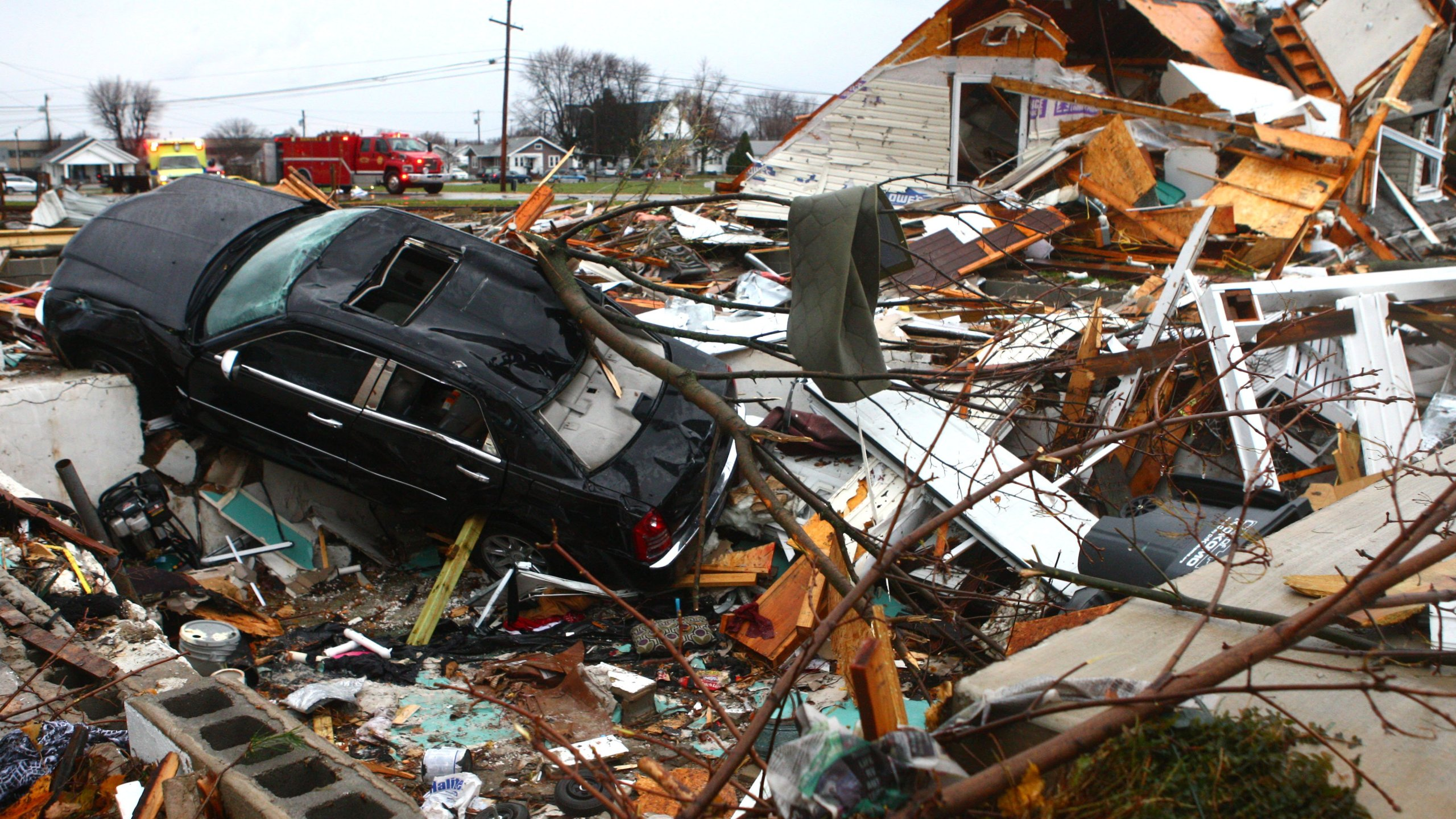 A car sits halfway in a basement at a leveled home near Home Avenue and Hoffer Street following an apparent tornado in Kokomo, Indiana, Sunday November 17, 2013.