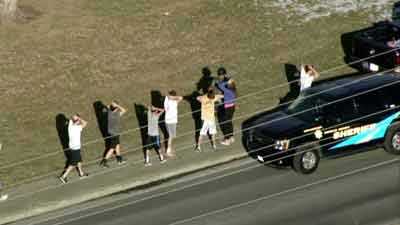 Students checked outside Arapahoe H.S